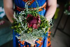 A bright and bold wedding filled with proudly South African touches like proteas, African print fabrics, strelizias, and the Joburg skyline! Protea Wedding, Wedding Bouquets, South African Weddings, Centrepieces, Christmas Traditions, Printing On Fabric, Flowers, Beautiful, Wedding Brooch Bouquets