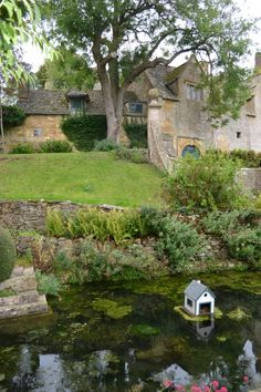 National Trust's Snowshill Manor  (pin via Eden C)  The swan/duck house is killing me!