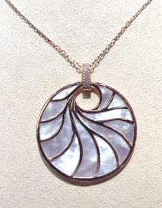 Frederic Sage mother of pearl pendant in 14k rose gold with .27 cts of diamonds.
