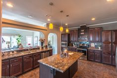 Working in the kitchen in doesn't shut you off from the rest of the family. The bar window provides a great place for homework, snacks, buffets and much more in the La Linda manufactured home by Palm Harbor with 3 Bedrooms, 2 Baths, 2280 Sq. Ft.