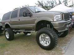 Lifted ford excursion!...not diggin the rims too much...