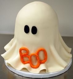 Fondant ghost cake    This is a four layer vanilla cake, iced in vanilla buttercream and then covered in marshmallow fondant. The eyes and the Boo are also marshmallow fondant.
