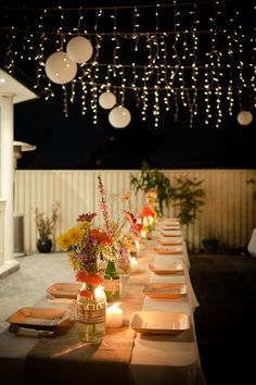 Howard and Linda's Engagement Party | eatshowandtell. Happy flower colors and lights for a rehearsal dinner!
