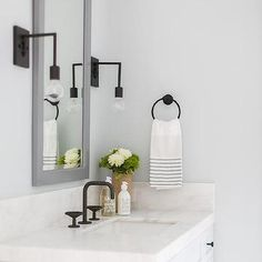Black bathroom details we 🖤. sconces, hardware + faucet all in a flat black finish (and a bonus! you can purchase the sconces on… Bronze Wall Sconce, Rustic Wall Sconces, Bathroom Wall Sconces, Candle Wall Sconces, Basement Bathroom, Bathroom Faucets, Newport Beach, Traditional Wall Sconces, Sconces Living Room