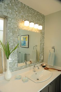 "Alico makes a similar vanity light called ""BORG... this Alco Borg lighting...square bar light... lights and mosaics with smooth countertop... like the tile, mirror and lights."