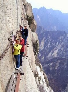 Don't look down: Hikers navigate the walkway on Huashan mountain, China |See More