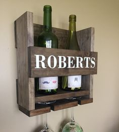 This personalized wine rack is the perfect addition to your home and makes for a very special wedding gift, housewarming gift or for other occasion! Each wine rack is individually handcrafted with quality boards and is personalized with your last name! Wine Holder + Wine Glass Holder PERSONALIZED WITH LAST NAME Dimensions - 11.5 wide x 11.5 tall x 5 deep - Holds 2 Wine Bottles + 2 Wine Glasses - Thick Solid Wood - Beautiful Light Brown Rustic Stain - No Assembly Required - Hanging Materia...