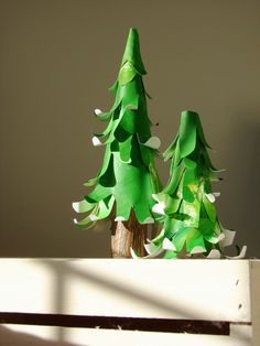 How to make paper trees from cut out hand prints and cones.