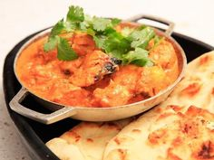 The secret to our Chicken Tikka Masala is a salty yogurt-based marinade followed by intense charring on a hot grill. We purposely undercook our chicken so it can simmer in a creamy spiced tomato and cream sauce before serving.\n\nWhen done right, the sauce should be a multifaceted affair; a balanced blend of intense spice flavors with a gingery kick rounded off by the richness of cream and butter, with a splash of freshness and acid from tomatoes and citrus. As you bite into a chunk of ...