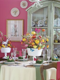 pretty tablescape.... I love the butterflies on the outside of the vase