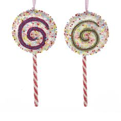 New candy lollipops with swirls, peppermint stripes and lots of candy sprinkles!  Shop for more candy themed Christmas ornaments and decorations at Shelley B Home and Holiday http://shelleybhomeandholiday.com/shop-by-theme/candy-and-sweets-christmas-decorations/