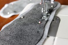 Sew the felt onto the fleece.