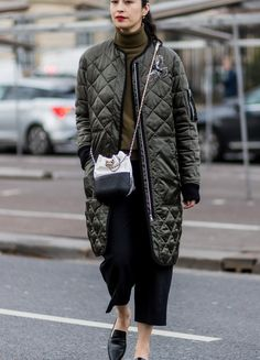 streetstyle: puffer jacker. puffer coat. military style. trousers. style. fashionista. fashio week