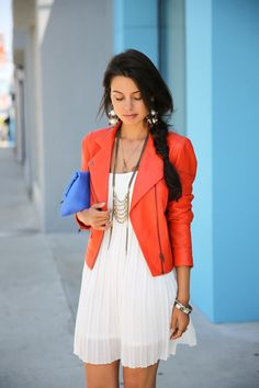 Structured jacket juxtaposed with a delicate white dress. Blue clutch pops against the orange, and the statement jewelry ties it all together.