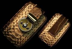 This iPhone wallet was specially created in only 3 pieces, by designer Davide De Nizza in joint collaboration with artist Stuart Hughes and launched as a part of the Tamara range. Materials used in it include python skin, nubuck, croco slow brown, 46 grams of 18K gold and a total of 35 finely cut diamonds