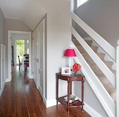 To recreate the warm entrance from this episode of The Design Doctors, ask your local Dulux stockist to mix you up colour reference 10 YY 46/041 and use it throughout your entrance hall and stairs #designdoctors #hall #colour #inspiration