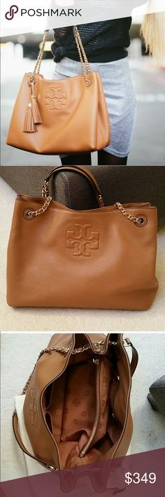 """Tory Burch Thea Chain Slouchy Tote Preloved Tory Burch Thea Slouchy Tote in Excellent Condition. Width (at base): 14"""" Height: 10"""" Depth: 5"""" Shoulder Strap Drop: Adjustable **Product Details:  Pockets: Two interior open, Two interior zip, Closure: Magnetic Snap. A classic Tory Burch shoulder bag in supple light brown leather with a central embossed logo and gold-tone hardware. Details include two woven chain shoulder straps, leather tassels, a magnetic snap closure, and fully lined interior…"""