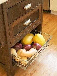 Vegetable Storage Onions, potatoes, and squash do best when stored in a cool, dry place. Give them what they need by storing them out of the way in a pullout wire basket beneath standard drawers. Would be nice for a kitchen island. Kitchen Island Storage, Kitchen Redo, New Kitchen, Kitchen Remodel, Kitchen Design, Kitchen Cabinets, Kitchen Ideas, Kitchen Islands, Kitchen Organization
