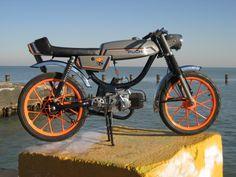 Garage. Cool moped.