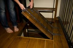 Medieval loft door on top of ladder, Murphy's bed in loft so space can be used for other things when not sleeping!