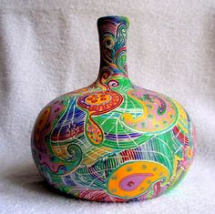 a vase decorated with polymer clay