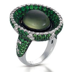 This eye-catching ring features green tsavorite and diamonds surrounding a beautiful pearl