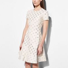 Coach Circle Leather Dress With Whipstitch Eyelet ($2,500) ❤ liked on Polyvore featuring dresses, chalk, white lace up dress, laced dress, white circle dress, americana dress and american dress