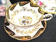 Grosenvor tea cup and saucer black and gold gilt floral painted teacup