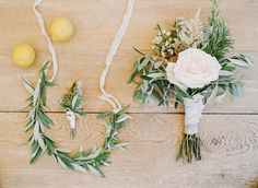 white roses, cafe au lait dahlias, rosemary, olive leaves, moss, and pods.