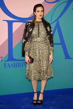 New Trending Celebrity Looks: CFDA Awards 2017: Mandy Moore Does it Again. You know, we're really starting to respect this gal.      When it comes to fucking up a look, girlfriend really commits. Not only did she pick a dowdy minister's wife dress in a decidedly unchurchy print, she paired it with a jacket that absolutely does not go with it in any...