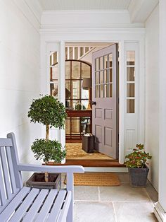 This recessed entry is protected from the elements and has classy vibes thanks to a gray and white palette: http://www.bhg.com/home-improvement/door/exterior/traditional-front-doors/?socsrc=bhgpin022215quietandclassy&page=12