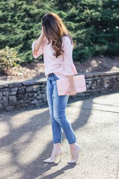 Women's spring fashion idea via Peaches In A Pod blog. Cute pink bell sleeve top and boyfriend denim.