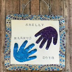 Sibling hand print impressions in clay with speckled purple and blue and our classic textured border. Baby Hand And Foot Prints, Hand Prints, Baby Hands, Pottery Studio, Pottery Ideas, Clay Projects, Sibling, Footprint, Purple