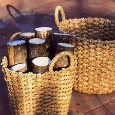 basket for firewood on a porch.... baskets are one of the cheapest things at Goodwill, and you won't worry over them being exposed to elements