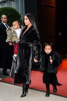 Kim Kardashian West, North West, and Saint West in Coordinated Statement Coats in New York City