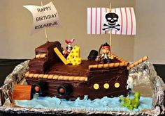 Homemade Jake & the Neverland Pirate Ship Cake: For this Jake & the Neverland Pirate Ship Cake I baked 2 (9x13) cakes. I sliced off a little from the top to make them stack evenly. Shape the front of