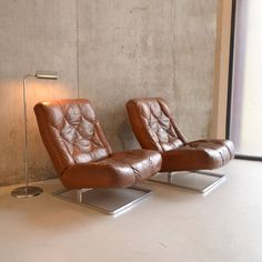 mid century leather chairs possibly by percival lafer by proper. | notonthehighstreet.com