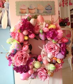 Spring is in the air:) I love decorating my front door for each occasion. Mixing flowers, polystrene eggs and toys, I made an easter wreath for my shop.