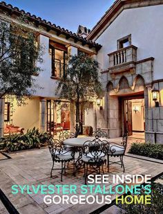 This courtyard at Sylvester Stallone's California home is so charming. We love the stone floor and cute table. Even if you're short on space, you can create this look in the smallest of backyards.