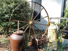 Rent this wood wheel to create a rustic escort card display from southernvintagegeorgia.com