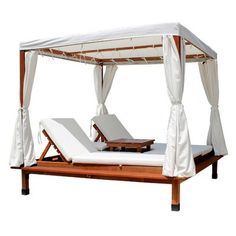 Upscale outdoor cabana crafted of eucalyptus frame and acrylic upholstery includes canopy, cushions, curtains, and a table section with storage compartments. Outdoor cabana instantly gives a vacation feel. Outdoor Cabana, Pool Cabana, Beach Cabana, Outdoor Daybed, Outdoor Lounge, Outdoor Spaces, Outdoor Living, Patio Daybed, Outdoor Ideas