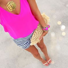 Love the bright pink top and the black and white striped shorts. Not a fan of the clutch and the necklace