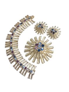 WOW! What a fantastic over-the-top design! Straight from the age of Sputnik and the atom comes this full parure by Emmons. Spiky bracelet