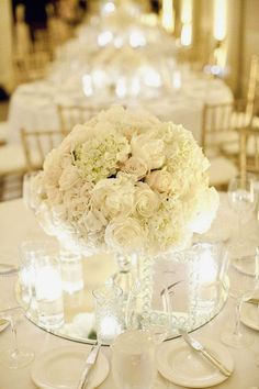white roses and hydrangea wedding centerpiece / http://www.himisspuff.com/simple-elegant-all-white-wedding-color-ideas/11/
