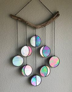 http://sosuperawesome.com/post/172390015310/stained-glass-moon-phase-wall-hangings-and-moon