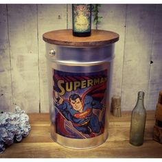 Comic superhero stools with wooden opening lid in silver, reclaimed old paint pots these are sure hit for children's bedrooms storage, hide messy toy clutter Ergonomic Computer Chair, Recycled Plastic Adirondack Chairs, Bedroom Seating, Accent Chairs For Living Room, Painted Pots, Bedroom Storage, Book Gifts, The Beatles, Superman