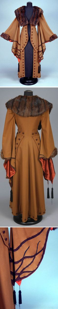 Wool, with those sleeves appliquéd in darker brown with black silk tassels, fur collar and cuff, contrasting faux button trim, and satin lining.