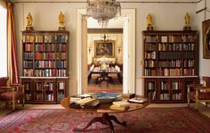 The library at Clarence House. George VI's bookcase is on the left, and The Queen Mother's on the right. Royal Collection Trust / © Her Majesty Queen Elizabeth II 2015. Photographer: Christopher Simon Sykes