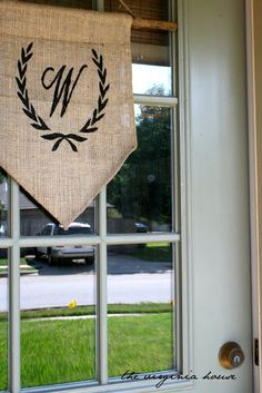DIY::DOOR FLAG.  Perfect for the front of the house. You can fit a tension rod between your door and the screen door. The flag will look great! Hang holiday flags, banners, etc. on a tension rod and take it down when not in use. The door will close just fine!