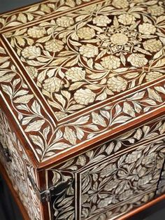 AN IVORY INLAID CABINET